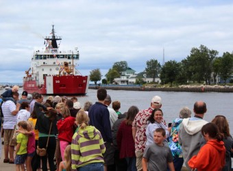 (Tribune photo/Krystle Wagner) Thousands of residents and visitors lined the Grand Haven channel on Monday to watch the Parade of Ships as part of the 2013 Coast Guard Festival.